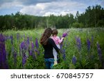 back view on young mom and cute ... | Shutterstock . vector #670845757