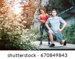 female personal trainer showing ... | Shutterstock . vector #670849843