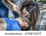 girl helping an unconscious guy ... | Shutterstock . vector #670874257