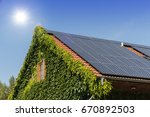 solar panels on a roof with...