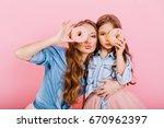 attractive curly girl in denim... | Shutterstock . vector #670962397