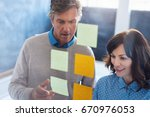 two casually dressed work... | Shutterstock . vector #670976053