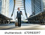 young businessman one hand... | Shutterstock . vector #670983097