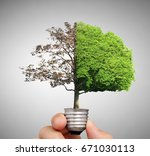 hand holding a light bulb with... | Shutterstock . vector #671030113
