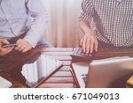 businessmen meeting to discuss... | Shutterstock . vector #671049013