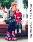 young girl hugging her little... | Shutterstock . vector #671125483