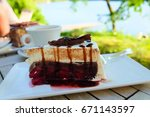 cake and coffee on the wooden... | Shutterstock . vector #671143597