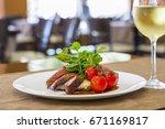 bacon wrapped pork medallions... | Shutterstock . vector #671169817