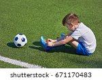 Boy Football Soccer Tying The...
