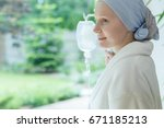 woman in white robe smiling and ... | Shutterstock . vector #671185213