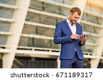 businessman using tablet and...   Shutterstock . vector #671189317