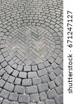 Small photo of Inner circle pattern of cobble brick work for paved pedestrian area