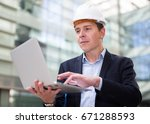 smiling man with documents in... | Shutterstock . vector #671288593