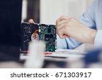 programmer repairs computer... | Shutterstock . vector #671303917