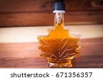 maple syrup  bottled in the... | Shutterstock . vector #671356357