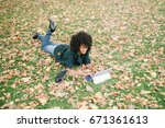 young black woman lying on... | Shutterstock . vector #671361613