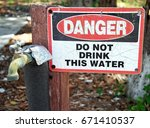 faded danger do not drink this... | Shutterstock . vector #671410537
