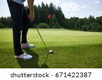 playing golf on a golf course | Shutterstock . vector #671422387