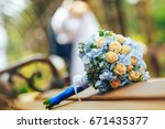 wedding bouquet on the bench in ... | Shutterstock . vector #671435377