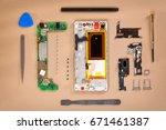 smartphone disassembled into... | Shutterstock . vector #671461387