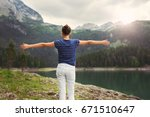girl enjoying in the nature... | Shutterstock . vector #671510647