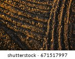 black soil plowed field. earth... | Shutterstock . vector #671517997