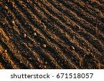 black soil plowed field. earth... | Shutterstock . vector #671518057