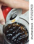 pouring of cola | Shutterstock . vector #671522923