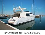 white yacht in the port waiting.... | Shutterstock . vector #671534197