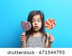 beautiful little girl with...   Shutterstock . vector #671544793