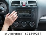 young woman turning audi button ... | Shutterstock . vector #671549257
