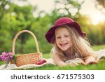 little girl playing and eating... | Shutterstock . vector #671575303