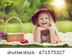 little girl playing and eating... | Shutterstock . vector #671575327