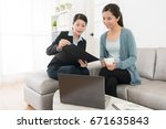 Small photo of professional young insurance agent woman going to customer's home introduce assurance planning and explaining risk management.