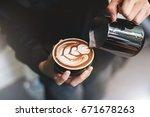 barista make coffee cup latte... | Shutterstock . vector #671678263
