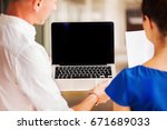two office workers looking at... | Shutterstock . vector #671689033