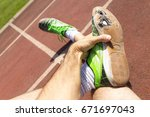 An Exhausted Athlete On A...