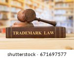 trademark law books and a judge ... | Shutterstock . vector #671697577