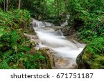 beautiful pha sawan waterfall... | Shutterstock . vector #671751187