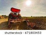 tractor in a  field | Shutterstock . vector #671803453