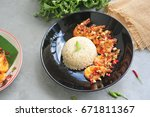 rice and shrimp fried with... | Shutterstock . vector #671811367