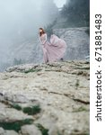 Small photo of A woman on a rock, an abrupt