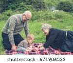 two grandparents are playing... | Shutterstock . vector #671906533