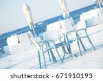 chairs and table of beach cafe... | Shutterstock . vector #671910193