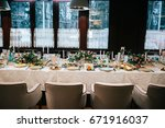 soft white chairs stand at... | Shutterstock . vector #671916037