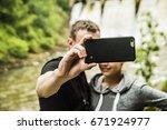 selfie couple taking smartphone ... | Shutterstock . vector #671924977