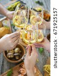hands with white wine toasting... | Shutterstock . vector #671925157