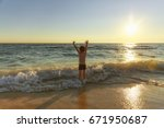 kid delighted by the sea. boy...   Shutterstock . vector #671950687