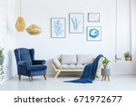 white sofa and blue armchair in ... | Shutterstock . vector #671972677