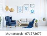 White Sofa And Blue Armchair I...